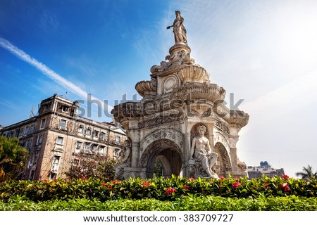 Flora Fountain and Oriental Old Building at blue sky in sunny at fort area in Mumbai, Maharashtra, India