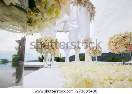 Floral arrangement at a wedding ceremony - stock photo