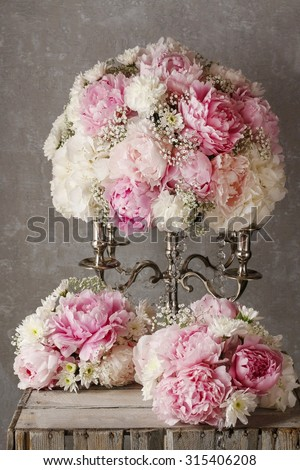 Floral arrangement with pink peonies, white chrysanthemums and gypsophila paniculata twigs - stock photo