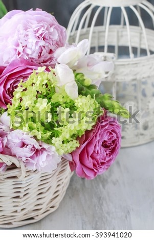 Floral arrangement with pink roses, peonies and matthiola flowers - stock photo