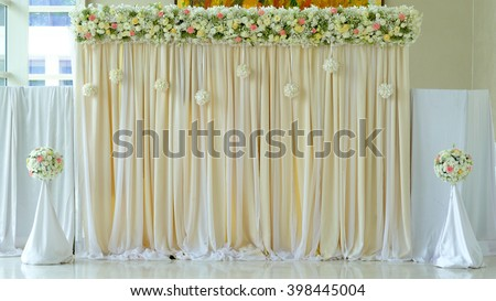 floral backdrop in cozy room at the wedding - stock photo