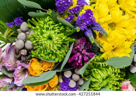 Floral background, macro flowers in a bouquet from chrysanthemum, roses, statice, alstroemeria. Shallow DOF - stock photo