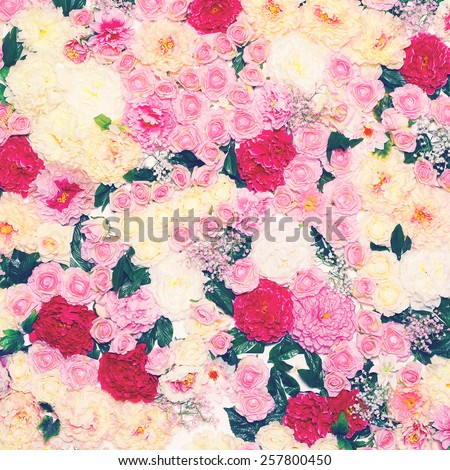 Floral background wall of flowers, toned photo gentle pastel colors  - stock photo