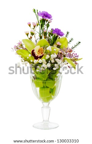 Floral bouquet of orchids, roses and carnation arrangement centerpiece in glass vase isolated on white background - stock photo