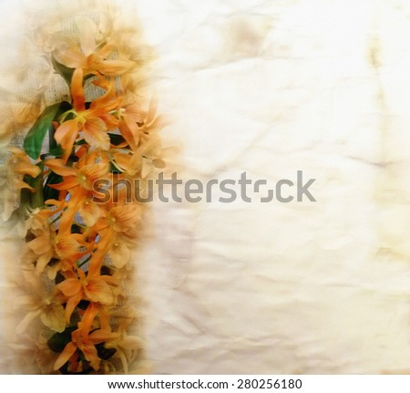 Floral card with orange orchid flowers on grunge crumpled aged paper background - stock photo