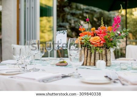 Floral centerpiece at a dinner - stock photo