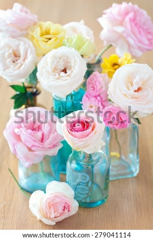Floral composition with a roses on a table.  - stock photo