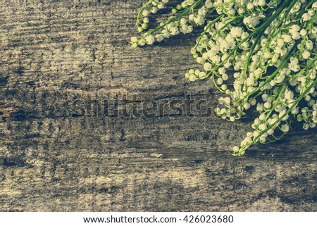 Floral corner with flowers on wooden background, copy space, vintage photo