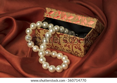 Floral gift box with pearls. Red Valentines day, birthday or celebration background.