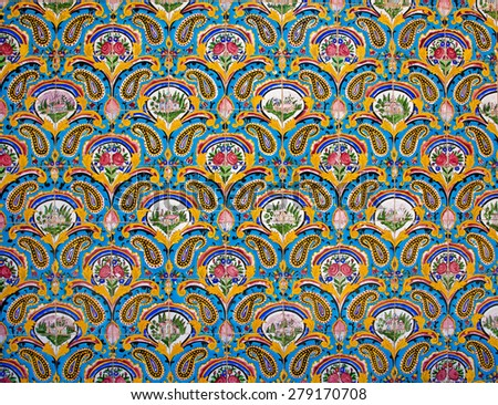 Floral pattern background of ceramic tiles in a historical royal palace in Iran - stock photo