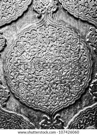 Floral pattern on a wooden door in Khiva. Uzbekistan - stock photo