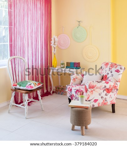 floral sofa yellow wall pink curtain with window classic room decor - stock photo