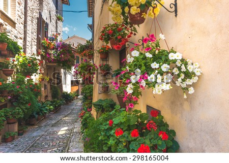Floral street in central Italy, in the small Umbrian medieval town, Italy