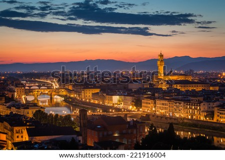 Florence after sunset from Michelangelo square: Palazzo Vecchio, Arno River, Ponte Vecchio, beautiful sky, hills in distance - stock photo