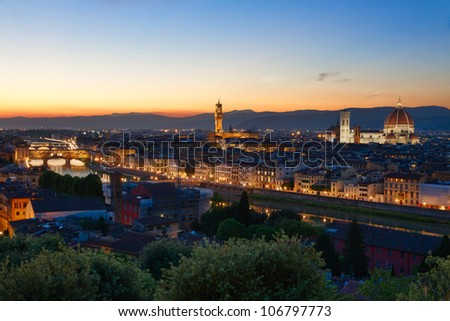 Florence, Arno River and Ponte Vecchio after sunset, Italy