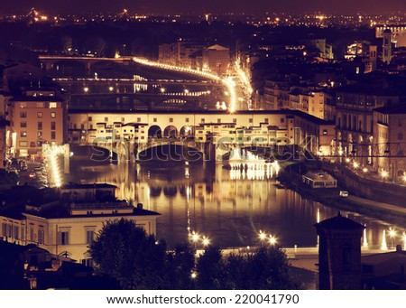 Florence, Arno River and Ponte Vecchio by night, Italy.  - stock photo