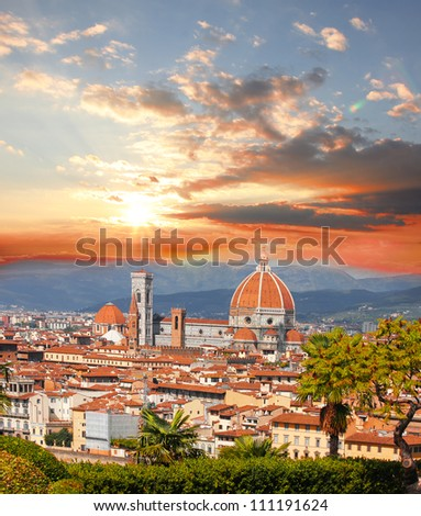 Florence Cathedral against colorful sunset in Italy - stock photo