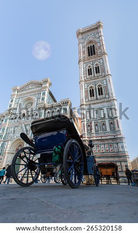 Florence Cathedral (Duomo - Basilica di Santa Maria del Fiore) during day from street level (Piazza del Duomo) - stock photo