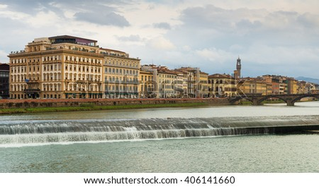 Florence cityscape in cloudy winter day, view on river Arno, September of 2012, Italy