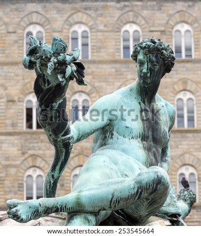 Florence (Firenze, Tuscany, Italy): medieval buildings in Piazza della Signoria, and the Neptune's Fountain - stock photo