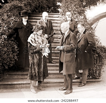 Florence Harding and Treasury Secretary Andrew Mellon outside White House. Ohio Gang leader, Harry Daugherty his wife, and roommate, bag man, 1924 suspicious death victim, Jess Smith. Dec. 20, 1921.