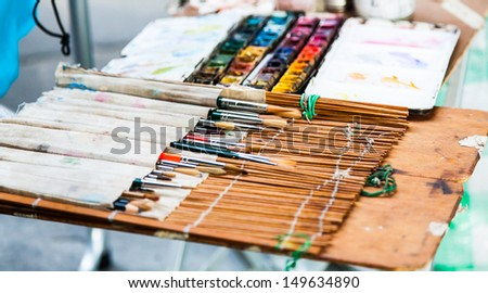 Florence, in front of one of the most important Italian Art School. Detail of a street artist tools. - stock photo