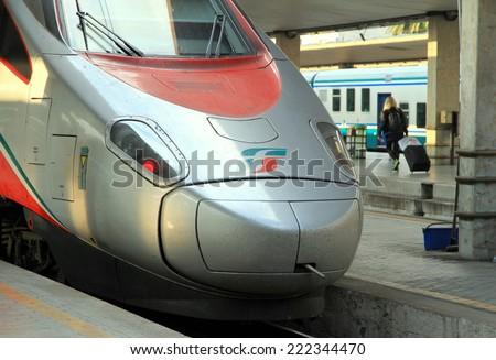FLORENCE, ITALY - APRIL 24, 2014: A Trenitalia Freccia Rossa train at the platform in the Santa Maria Novella station in Florence, Italy. - stock photo