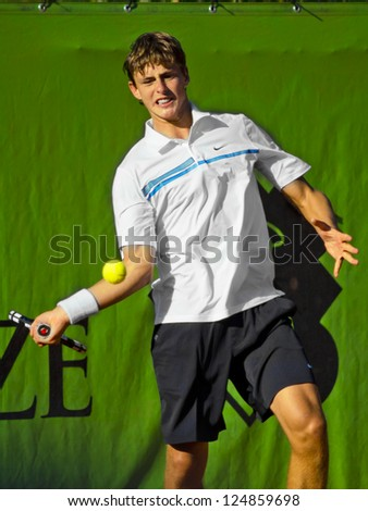 FLORENCE, ITALY - APRIL 09: Albert Alcaraz Ivorra plays a forehand at 37th City of Florence on April 09, 2012 in Florence, Italy - stock photo
