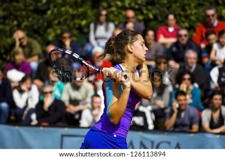 FLORENCE, ITALY - APRIL 09: Ana Konjuh plays a backhand at 37th City of Florence on April 09, 2012 in Florence, Italy - stock photo