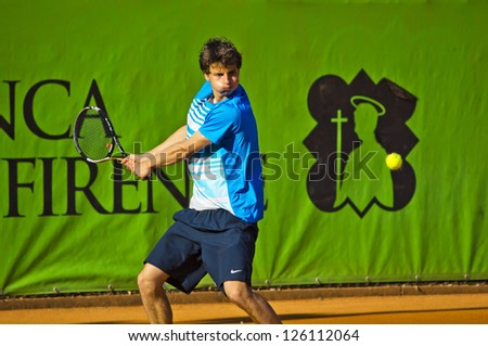FLORENCE, ITALY - APRIL 09: Blaz Bizjak plays a backhand at 37th City of Florence on April 06, 2012 in Florence, Italy - stock photo