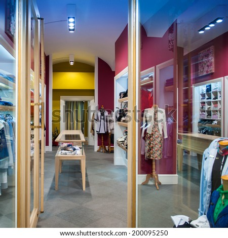 FLORENCE, ITALY - APRIL 12, 2012: Interior view of women's clothing store with diverse clothing and mannequins as seen in Florence, Italy caital of textile and silk - stock photo