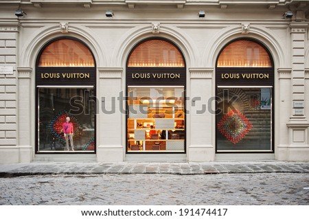 FLORENCE, ITALY - APRIL 16, 2012: Louis Vuitton flagship store in the Piazza degli Strozzi, luxury shopping street in Florence on April 16, 2012. The Louis Vuitton label was founded by Vuitton in 1854