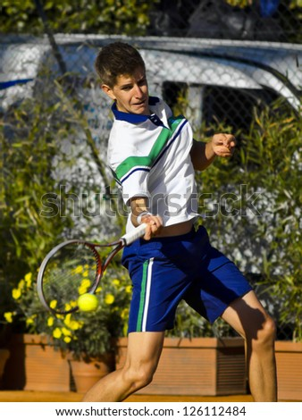FLORENCE, ITALY - APRIL 09: Matteo Donati plays a forehand at 37th City of Florence on April 09, 2012 in Florence, Italy - stock photo