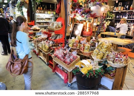FLORENCE, ITALY - APRIL 30, 2015: People shop at Mercato Centrale market in Florence, Italy. The market is an ultimate Italian shopping experience. It was opened in 1874. - stock photo