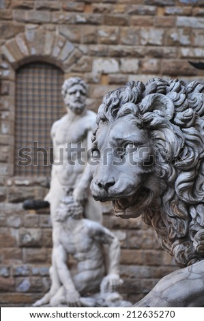 FLORENCE, ITALY - APRIL 20,2014: Statue of a lion at the Loggia dei Lanzi in Piazza della Signoria in Florence Tuscany. Michelangelo's David statue in front of the Palazzo Vecchio background