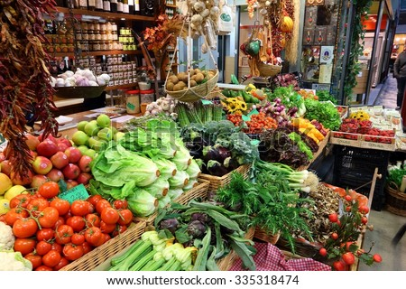 FLORENCE, ITALY - APRIL 30, 2015: Vegetables at Mercato Centrale market in Florence, Italy. The market is an ultimate Italian shopping experience. It was opened in 1874. - stock photo