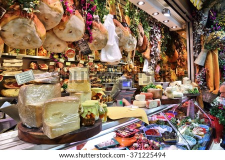 FLORENCE, ITALY - APRIL 30, 2015: Vendor sells cheese at Mercato Centrale market in Florence, Italy. The market is an ultimate Italian shopping experience. It was opened in 1874. - stock photo