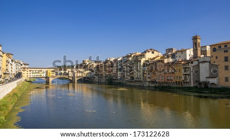 FLORENCE, ITALY - AUGUST 03, 2008: Beautiful view of bridge Ponte Vecchio, Florence, Italy. The historic centre of Florence attracts millions of tourists each year.