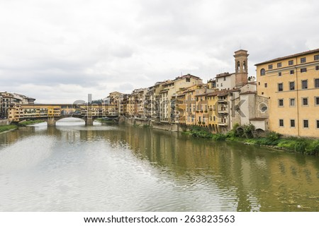 FLORENCE,ITALY-AUGUST 26,2014:view of ponte vecchio over the river Arno during a cloudy day