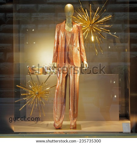 FLORENCE, ITALY - DEC 5: Gucci boutique in Florence on famous for luxury shopping Tornabuoni street on December, 5, 2013. Gucci was founded by Guccio Gucci in Florence in 1921. - stock photo