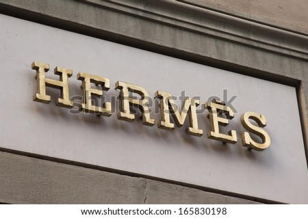 Florence, ITALY - December 8, 2011: Hermes Florence Store Logo Italy mounted on the marble wall of Hermes Store at Via de' Tornabuoni, the heart of Florence high-class shopping district