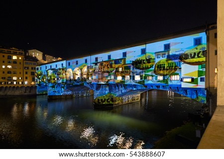 "FLORENCE, ITALY - DECEMBER 16, 2016: International Festival ""F-LIGHT"". Laser video mapping show on facade of the PONTE VECCHIO in Florence, Italy"