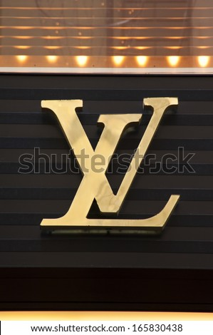 Florence, ITALY - December 8, 2011: Louis Vuitton Florence Store Logo Italy mounted on the marble wall of Louis Vuitton Store at Via de' Tornabuoni, the heart of Florence high-class shopping district - stock photo