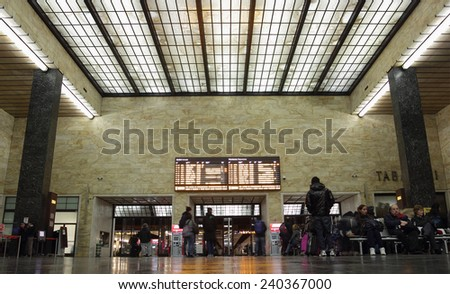 FLORENCE, ITALY - DECEMBER 7, 2014: People in the waiting room at Santa Maria Novella Railway Station - stock photo