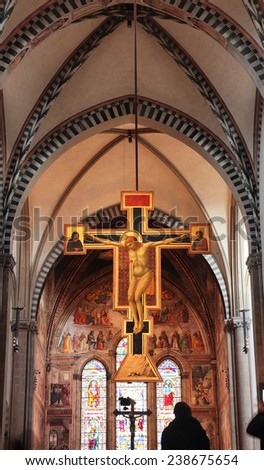 FLORENCE, ITALY - DECEMBER 7, 2014:the central nave in Santa maria Novella Church with magnificent crucifix by Giotto, painted  between 1288 and 1289. - stock photo