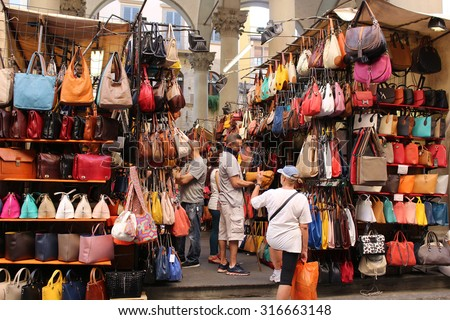 FLORENCE, ITALY, JUNE 23, 2015 : An outdoor market selling colorful leather goods such as handbags  in the centre of the city in Florence Italy - stock photo