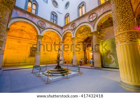FLORENCE, ITALY - JUNE 12, 2015: Arcs decorating the main yard of Old Palace in Florence, in the middle an angel fountaine
