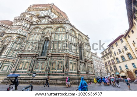 FLORENCE, ITALY - JUNE 30, 2017: Daylight view from bottom to Florence Cathedral of Saint Mary of Flower. Tourists walking on street.