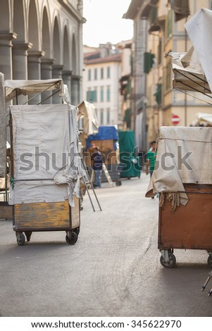 Florence, Italy-June 2, 2015. Early morning at the famous San Lorenzo outdoor leather market during the  set up of the market stalls - stock photo