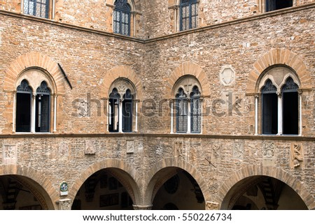 Florence, Italy-June 12, 2015. Exterior view of a section of the architecture of the National Museum of Bargello, a former barracks and prison, now an art museum